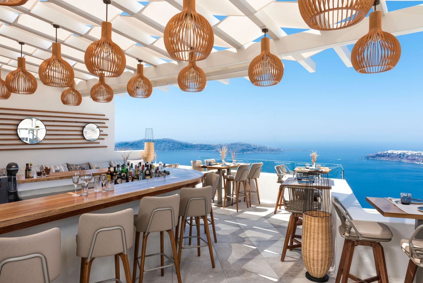 White Lounge Restaurant In Santorini With Stunning Views Of The Volcano And Aegean Sea